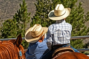 This father and son are watching the action at the Pritchard Rodeo.
