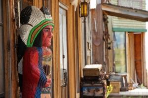 Cigar store sculpture in front of saloon