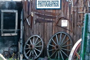 a wall with saws and a photographer's sign